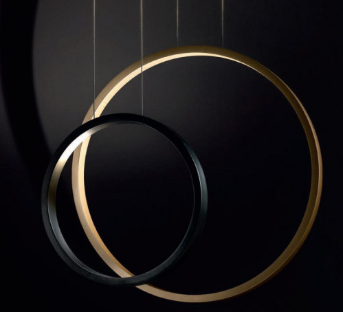 Cini & Nils Assolo 70 pendant lamp gold (at the right)